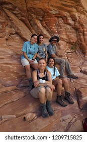 Grand Canyon National Park, Arizona - 05/27/2016: Backpackers rest during their ascent of the very strenuous New Hance Trail in Grand Canyon National Park.