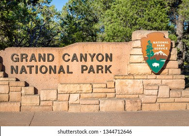 Grand Canyon National Park entrance monument sign on a beautiful sunny day with blue sky in summer, Arizona, USA