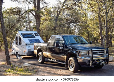GRAND CANYON NATIONAL PARK, USA - May 28, 2015: Pick-up truck with camping trailer at a Grand Canyon campground. Camping is a popular way to visit this National Park for thousands of people each year.