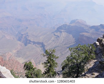 Grand Canyon National Park viewed from the South Rim on a hazy day with smoke from a wildfire.
