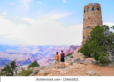 Grand Canyon people hiking. Hiker couple enoying view. Indian Desert View Watchtower, south rim of Grand Canyon, Arizona, USA