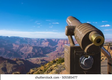 Grand Canyon viewpoint and a coin operated telescope. Afternoon at the Grand Canyon national park.