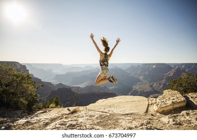 Grand Canyon Woman Jumping for Joy Millennial Summer Adventure at National Park