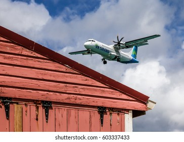 GRAND CASE -  AUGUST 02: Air Caraibes airplane is landing to L`Esperance airport seen in Grand Case St.Martin/St.Maarten on August 2, 2015