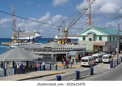 GRAND CAYMAN, CAYMAN ISANDS - CIRCA DECEMBER 2017: Overhead view of the cruise ship terminal, with a ship moored in the harbor in the distance, and cranes along the quay