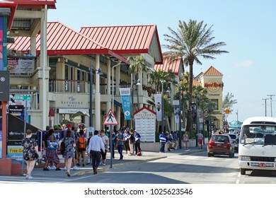 GRAND CAYMAN, CAYMAN ISANDS - CIRCA DECEMBER 2017: Mall filled with tourists shops across from the harbor