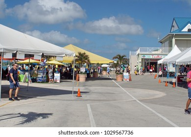 GRAND CAYMAN, CAYMAN ISLANDS - CIRCA DECEMBER 2017: Tourists at the cruise ship terminal