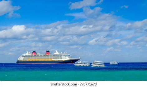 Grand Cayman, Cayman Islands, Dec 2017, cruise ship Disney Fantasy with marine shuttles on the Caribbean Sea near George Town port