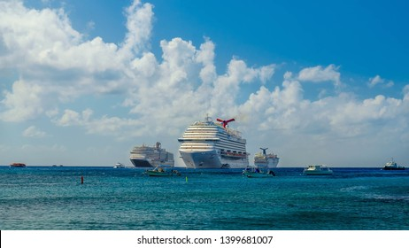 Grand Cayman, Cayman Islands, Dec 2018, cruise ships on the Caribbean Sea moored by the coast of George Town