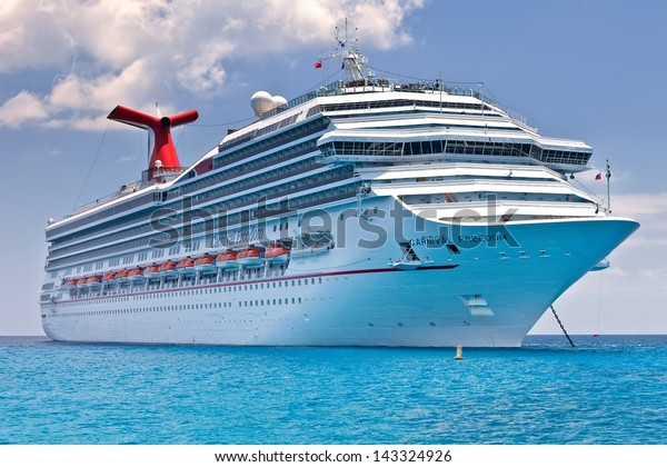 GRAND CAYMAN, CAYMAN ISLANDS - JULY 13:  Carnival's Ship, Carnival Freedom, anchored off the coast of Grand Cayman on July 13, 2011.  Passengers have to be tendered to the island for day excursions.