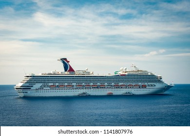 Grand Cayman, Cayman Islands - March 18,2015: Luxury cruise ship Carnival Freedom is sailing out of the port
