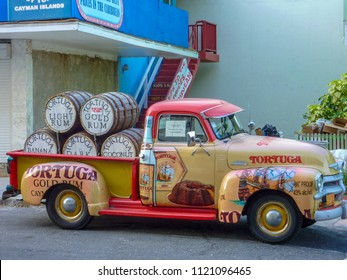 Grand Cayman / Cayman Islands - May 20 2011: Antique 1951 Chevy truck loaded with Tortuga Gold Rum on Grand Cayman