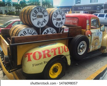 Grand Cayman - Nov 2015 Classic vintage antique 1951 Chevy truck loaded with Tortuga Gold Rum , brand is well-known by the more than 20 million annual Caribbean tourists and cruise ship passengers