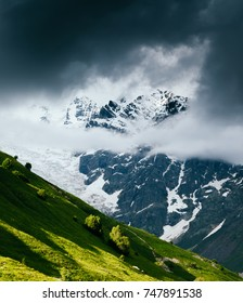 Grand cliffs near Mt Tetnuldi. Location Upper Svaneti, Georgia country, Europe. Main Caucasian ridge. Scenic image of lifestyle hiking concept. Adventure summer vacations. Explore the beauty of earth