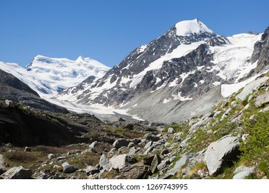 The Grand Combin is a mountain massif in the western Pennine Alps in Switzerland. With its 4,314 metres (14,154 ft) highest summit, the Combin de Grafeneire, it is one of the highest peaks in the Alps