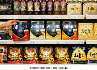 GRAND EST, FRANCE - AUGUST 16, 2017: Assortment of different brands of Belgian beer in cardboard 6-pack packings in a French Super U supermarket.