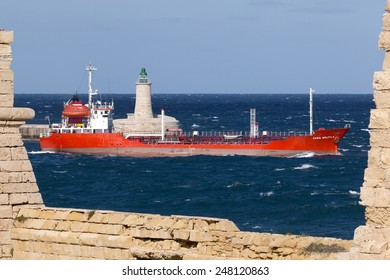 """Grand Harbour, Malta January 29, 2015: Vessel named """"KAROL WOJTYLA"""", registered with IMO number 9016454 and MMSI 248121000, leaves harbour."""