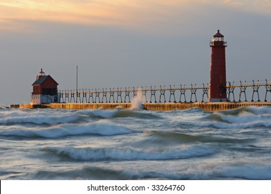 Grand Haven, Michigan lighthouses with splashing waves, pier, and catwalk, Lake Michigan