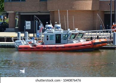 """Grand Haven, Michigan / USA- August 1, 2016: Coast Guard boats docked at the Coast Guard Station"""