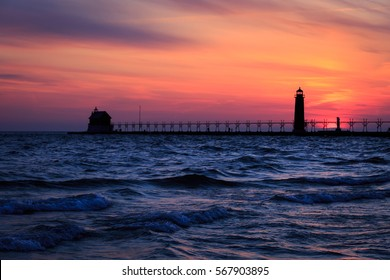 Grand Haven South Pier Lighthouse, two bright red lighthouses on a long breakwater with an elevated catwalk provide a great setting.