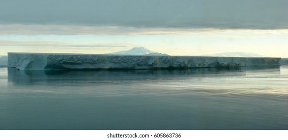 Grand iceberg, Mount Discovery and Beautiful Clouds