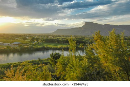 Grand Junction, Colorado, USA- August 2, 2017: View of Book Cliff Mesas from Palisades, Grand Junction, Colorado. Next to Colorado River and vineyard at grape harvest.