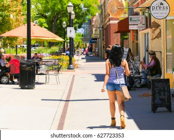 GRAND JUNCTION, USA - MAY 28, 2016: The main street of the city with people strolling along or sitting in one of the street cafes.