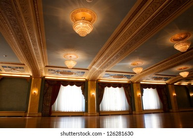 Grand, old fashioned ballroom with glass chandeliers.