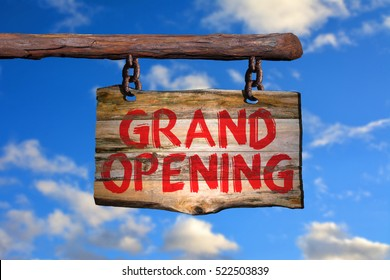 Grand opening motivational phrase sign on old wood with blurred background