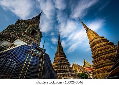 Grand Palace Bangkok Decorative Pagodas against blue sky. Wat Phra Chetuphon Vimolmangklararm Rajwaramahaviharn