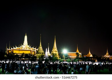 Grand Palace, Bangkok : Oct 15th, 2016 Night time in front of Grand Palace Thai mourners wearing black color waiting to pay tribute and respect to their beloved King Bhumibol Adulyadej