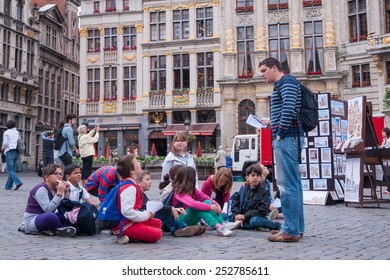 The Grand Palace of Brussels, Belgium - June 25,2013 : Teacher and children on a field trip