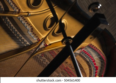 A grand piano inside closeup with iron string, gold plate in hotel, seoul, korea.