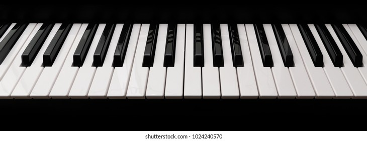 grand piano keyboard with glossy black and white keys as a music background in wide panoramic banner format, selected focus, narrow depth of field