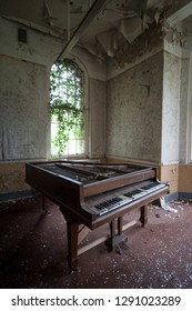 Grand piano left at an abandoned and derelict lunatic asylum/hospital (now demolished), Cane Hill, Coulsdon, Surrey, England, UK
