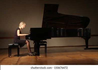 Grand piano pianist playing classical concert. Player with musical instrument