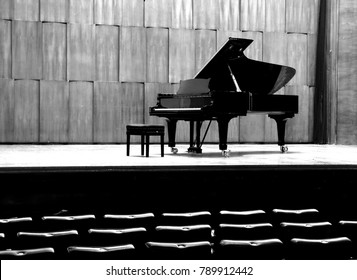 Grand piano set on stage, B&W