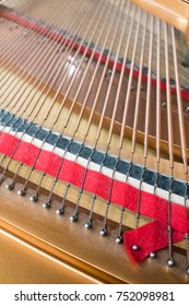 Grand piano strings. Piano inside with the shallow depth of field.