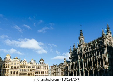 The Grand Place of Brussels with bluish sky.