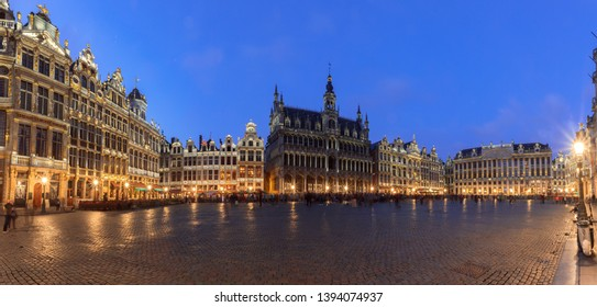 Grand Place square in Brussels with night lighting, illuminated facades, Belgium. The main attraction of Brussels at night. Brussels Town Hall, City Museum