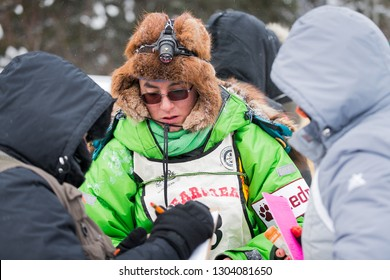 GRAND PORTAGE, MN - JANUARY 29, 2019: Ryan Redington meets with race officials prior to leaving Mineral Center during the John Beargrease Sled Dog Marathon. Redington finished 6th on January 29th.
