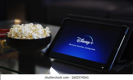 Grand Prairie, TX/US Sep 2019: Disney Plus logo on tablet screen with popcorn and candy. Disney+ is a new streaming service that has Star Wars, Pixar, and Disney related content.