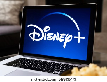 Grand Prairie, TX/USA - Aug 2019: Disney Plus on a MacBook screen next to a bowl of popcorn. Dinsey+ is a new streaming subscription service