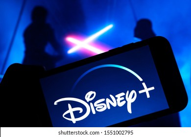 Grand Prairie, TX/USA Oct 2019: Disney Plus on smartphone screen with Star Wars in the background. Dinsey+ is a new streaming subscription service that will feature Marvel, Pixar, and Star Wars.