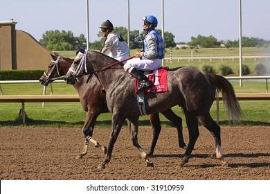 GRAND PRAIRIE,TX - JUNE 6th: Jockey riding his horse after race at Lone Star Park Horse Race June 6th, 2009 in Grand Prairie, Texas.