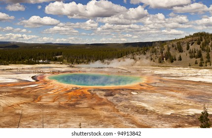 The Grand Prismatic Spring in Yellowstone National Park is the third largest hot spring in the world. With patterns of algae radiating from the dark blue pool, it is a colorful view.