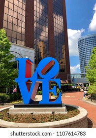 GRAND RAPIDS, MI - MAY 16, 2018: Iconic pop art blue LOVE sculpture in downtown Grand Rapids. It consists of the letters LO over the letters VE and is 8 foot wide 8 foot tall and 4 feet deep.