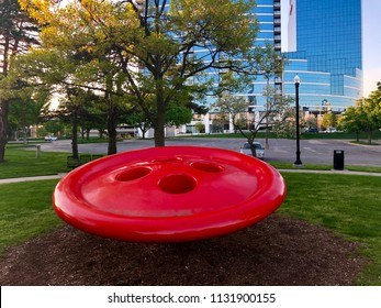 GRAND RAPIDS, MI - May 16, 2018: Lorrie's Button sculpture created by Hy Zelkowitz. It is in Ah-Nab-Awen Park near President Ford's Museum. It is designed for children to play on it.