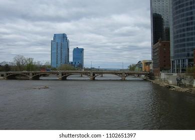 GRAND RAPIDS, MICHIGAN - APRIL 17: Buildings on the banks of the Grand River on April 17, 2010 in Grand Rapids, Michigan. Grand Rapids is known for its many breweries.