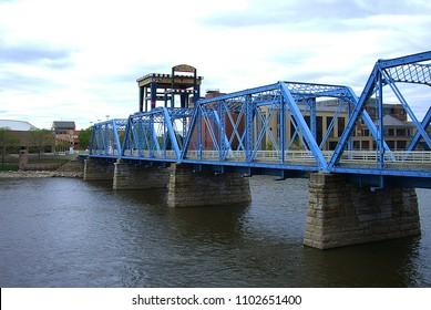 GRAND RAPIDS, MICHIGAN - APRIL 17: Iconic Blue Bridge on the Grand River on April 17, 2010 in Grand Rapids, Michigan. This former steel truss railroad crossing was converted to a foot bridge.